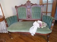 green velvet Victorian love seat and parlor side chair
